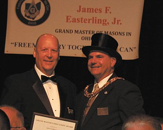 SPECIAL TO THE VINDICATOR Denny Furman, left, Argus Lodge 545 F&AM education officer, was awarded the grand master's education award by James P. Easterling Jr., grand master of Masons in Ohio, at the Ohio Masonic Grand Lodge annual meeting in Akron in October. The award recognizes the programs and practices that encourage excellence in the education of lodge members Furman has provided. He lives in Berlin Center with his wife, Mary Jo, where they own and operate Denny's Auto Supply.