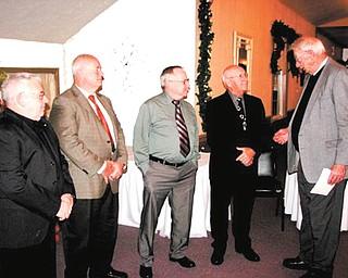Hugh Earnhart installed officers for 2014 at the Men's Garden Club of Youngstown's annual Christmas awards dinner. From left are Dennis Zap, president; Dave Causer, first vice president; Dan Burns, corresponding secretary; John Kolar, recording secretary; and Earnhart.  SPECIAL TO THE VINDICATOR