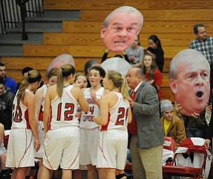 Columbiana head coach Ron Moschella talks to his starters including #21 Lauren Schlueter, #12 Aleah Whitacre, #10 Taylor Sims, #24 Emily Whitacre, and #5 Baylie Mook during a time out during the 1st half of Monday nights game.