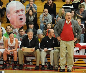 Columbiana head coach Ron Moschella coaches from the sideline during the 2nd half of Monday nights game.