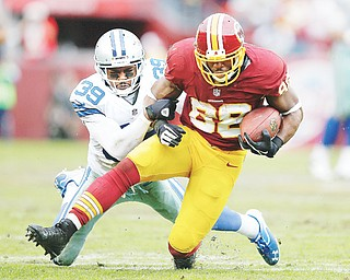 Washington Redskins receiver Pierre Garcon, a former standout at Mount Union University, is tackled by Dallas Cowboys cornerback Brandon Carr during the second half of their game Sunday.