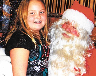 VFW Post 93, 2912 South Ave., Youngstown, recently hosted its annual Children's Christmas Party to benefit the families of post members. More than 40 children attended, and each one received food, treats and a gift. Above is guest Isabella Arigoni, 10, who shared her Christmas list with Santa, as did Mason Dutton, 2, below.