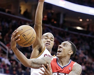 Atlanta Hawks' Jeff Teague (0) jumps to the basket against Cleveland Cavaliers' Jarrett Jack during the third quarter of a game Thursday in Cleveland. Teague made a game-winner at the buzzer of the second overtime for a 127-125 victory over the Cavaliers.