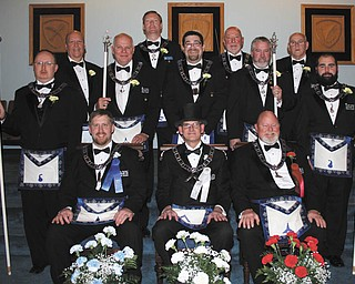 SPECIAL TO THE VINDICATOR On Dec. 13, Argus Lodge 545 F&AM of Canfield installed officers for 2014 at its 128th annual installation ceremony. Master of ceremonies was Thomas J. Hallden, and marshals were David Powell and John Craig. Installing officers were Hallden, Russell W. Gillam III, Richard Persic, Elmer Stalnecker, Dan Illeick, Russell W. Gillam Jr., Robert Edwards, Donald Huntley, Dale E. Hawkins and Elmer Foldvary. Next year's officers, seated, from left, are Ryan Hamilton, junior warden; Mark Roca, master; and Dale Hawkins, senior warden; in back are Richard Palmer, junior steward; Denny Furman, lodge education officer; Eric Cahalin, junior deacon; Russell W. Gillam III, treasurer; Christopher Gillam, chaplain; Clarence Shawver III, tyler; Charles Prachick, senior deacon; Huntley, secretary; and R. Patrick Anderson, senior steward. Thomas Eaton also was installed as trustee.