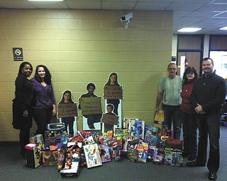 SPECIAL TO THE VINDICATOR Cub Scout Pack 114 and the Iron Order Motorcycle Club, Youngstown chapter, donated toys for the Mahoning County CASA/GAL program children. From left are Carla Baldwin Fields, CASA board member; Cathy Kristan, assistant director of Mahoning County CASA; John Theodore and Vicki Sullivan, CASA volunteers; and Joe Rzonsa, board member. The Mahoning County CASA Program trains volunteers to speak up for abused and neglected children in juvenile court. The program is a nonprofit organization that depends on grants, donations and fundraisers.