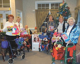 SPECIAL TO THE VINDICATOR Whispering Pines Village in Columbiana raised funds and bought $700 worth of toys for Columbiana's Toys for Tots program. The decorated Christmas Buggy Brigade, from left, are Donna Round, Mary Davis, Harry Neiheisel, Fern Oliver, Rosemary Magee and Betty Brooke.
