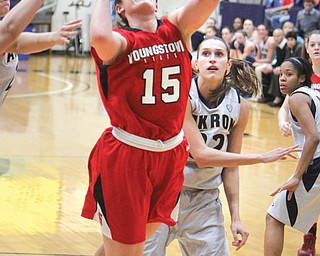 YSU's Heidi Schlegel goes for a layup after being fouled by Akron's Rachel Tecca during Sunday's game in Akron. Schlegel tied her career high in single game points with 27, but the Penguins fell 91-75 to the Zips.