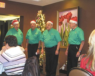 SPECIAL TO THE VINDICATOR Vocal Alliance Barbershop Quartet, a part of the Stephen Foster Chorus of Warren, provided musical entertainment and comedy for the Austintown Friends of the Library during its Dec. 21 Christmas party. Friends program chairman Doug Wilcox invited the group and a luncheon followed their performance. Hitting all the right notes were Jack Foley, left; John McCaughan, director of the chorus; Ray Pelyhes; and Jack Martin. The next meeting of the Austintown Friends will begin at 10 a.m. Jan. 27 with speaker Dr. Donna DiBlasio of the Youngstown Steel Museum. Guests are welcome.