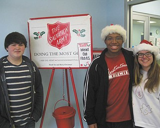 SPECIAL TO THE VINDICATOR On Dec. 21 members of Fitch High School's Interact Club donated time from their Christmas break to collect money for the Salvation Army at the Austintown Plaza. Members greeted patrons at the post office with a hearty Merry Christmas and opened doors for the customers. Some of those who donated their time were, from left, Justin Shaunesey, Ben Burney and Alison Rein.