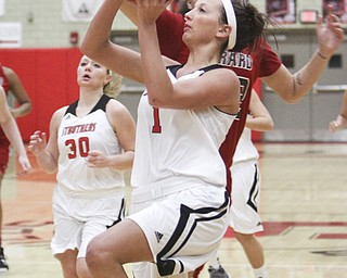 Ashleigh Ryan of Struthers goes for a layup against Girard defender Bree Bishop during the first quarter their game Monday at the Struthers Fieldhouse. Ryan posted 14 points or the Wildcats, who downed the Indians, 65-50.