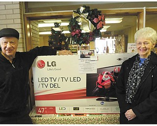 Special to The Vindicator: The Girard Multi-Generational Center sponsored a raffle recently for a 47-inch LG LED television. Winners of the TV above were June Phillips and her husband, George. Proceeds from the event benefited the center. For information about the programs and services offered at the center, call 330-545-6596 or visit www.multigen.org.
