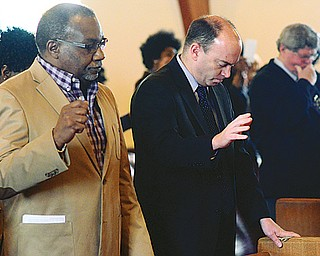 Youngstown Councilman L. Nathaniel Pinkard, D-3rd, left, and Mayor John A. McNally participate in the annual Emancipation Proclamation and Installation Service at Price Memorial AME Zion Church in Youngstown. The Wednesday service dealt with the state of the black community 151 years after President Abraham Lincoln signed the historic document freeing slaves.