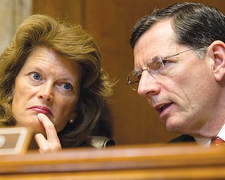Sen. Lisa Murkowski, R-Alaska, the Senate Energy and Natural Resources Committee ranking Republican, left, talks with committee member Sen. John Barrasso, R-Wyo., on Capitol Hill in Washington. The U.S. is racing to keep pace with stepped-up activity in the once-sleepy Arctic frontier, but it is far from being in the lead.