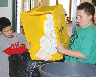 Ethan Lanave, left, and Caleb Adams, fourth-graders at Damascus Elementary School, empty paper from a recycling bin at the school, which has won numerous recycling awards, including five U.S. Environmental Protection Agency WasteWise awards.