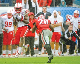 Nebraska wide receiver Quincy Enunwa catches a pass for a 99-yard touchdown reception in the second half of the Gator Bowl against Georgia on Wednesday in Jacksonville, Fla. The play — the longest in school history — gave the Cornhuskers the 24-19 win over the Bulldogs.