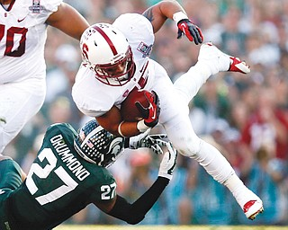 Michigan State safety Kurtis Drummond, a Hubbard High graduate, trips up Stanford running back Tyler Gaffney during the first half of the Rose Bowl on Wednesday in Pasadena, Calif. The Spartans stopped the Cardinal, 24-20, to win their first Rose Bowl in 26 years.