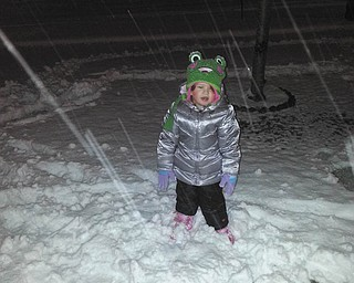 Bailey Christina Orr of Hubbard delights in playing in the snow.