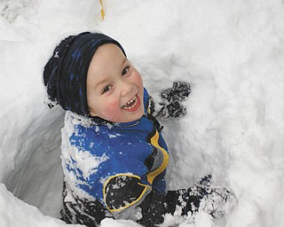 Ben Gaither, 2-year-old son of Becky and Bill Gaither of Austintown, frolicked in the pre-Thanksgiving Day snow tunnels made by his Uncle Mike Fox of Lowellville..