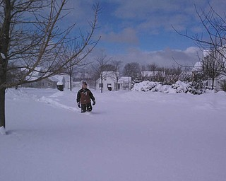 David Dull is shown trekking through the snow in St. Joseph, Michigan. David was visiting his aunt and uncle for the annual Ice Festival in February 2012. Sixteen inches of lake-effect snow fell overnight. The photo was submitted by his mom, Marla Dull.