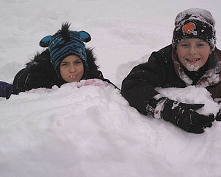 Andrea and David Dull are playing with (eating?) the snow in their backyard in Hubbard in the winter of 2012. Submitted by mom, Marla Dull.