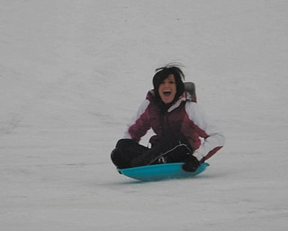 Dana gets a thrill out of sledding on the hill at Crandall Park. Photo was taken by her mom, Angie.