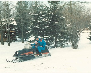 Lana Vanauker's brother Bill and her niece Angela relished riding a snowmobile in 1986 behind his home. Sent by Vanauker.