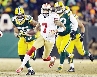 Forty-niners quarterback Colin Kaepernick (7) runs against the Packers defense during the first half of Sunday's NFC wildcard playoff game in Green Bay, Wis.