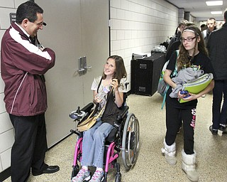 William D Lewis The Vindicator  Boardman Band Director Tom Ruggieri talks with band member Kaitlin Windt at Boardman HS 10-30-13. She is in a wheelchair and perfroms with the Boardman Marching band.
