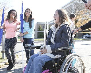 William D Lewis The Vindicator  Kaitlin Windt at Boardman HS 10-30-13. She is in a wheelchair and performs with the Boardman Marching band. She is shown with flagline members Alexis Perez, left, and Jessica Barone.