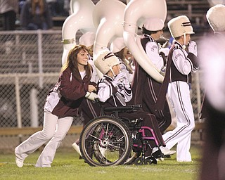 William D LEwis The Vindicator Boardman band member Kaitlin Windt, in wheelchair,  gets help from Rachael Ruggieri during 11012013 halftime show.