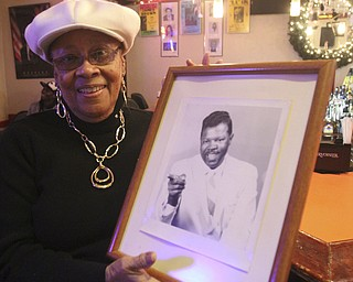 william D. Lewis The Vindicator  Frieda Anderson Martin owner of popular longtime jazz club , Frieda's on Y-towns Northside hold a photo of local musician Boogie D who helped her get live music started at the club.