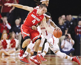 Ohio State guard Aaron Craft (4) steals the ball from Nebraska's Deverell Biggs (1) in the first half of a game in Lincoln, Neb., on Monday.