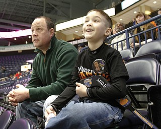 Chris Litton of Youngstown and his son Jack, 6, were among the few hardy souls who braved the brutal weather to watch the Youngstown Phantoms take on the Indiana Ice at the Covelli Centre in downtown Youngstown at the local hockey team's annual School Day Game. The weather caused many schools to cancel classes, and few students were able to make it to the center for the 10:15 a.m. contest Wednesday. The Phantoms have set another School Day Game for March 21, when the home team will skate against Team USA.
