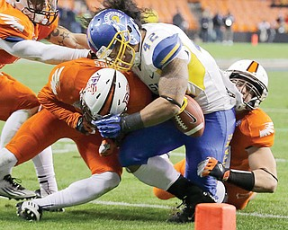 Bowling Green defensive back Cameron Truss delivers a hit on San Jose State's Ina Liaina, forcing a fumble