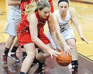 Fitch's Cassie Custer, left, and Boardman's Jenna Kuczek wrestle for a loose ball during Monday's game at Boardman High. The Spartans won, 52-49.