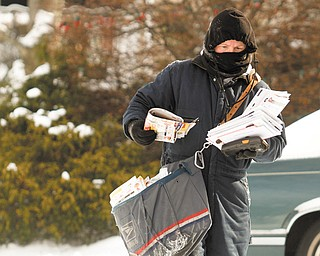 Carmen George makes sure to dress in layers when she delivers mail in Boardman during extremely cold weather.