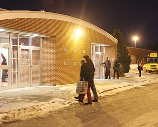 Basketball fans enter the Canfield High School gym to watch Wednesday's game between the Cardinal boys and Howland. The recent cold snap has caused numerous school across the Valley to close and cancel many of their