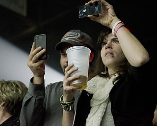 Katie Rickman | The Vindicator.Two fans take cell phone pictures during the first song at Elton John's concert at the Covelli Centre Saturday, February 1, 2014.