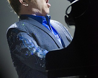Katie Rickman | The Vindicator.Elton John sings his song Funeral for a Friend/Love Lies Bleeding during the opening of his concert at the Covelli Centre Saturday, February 1, 2014.