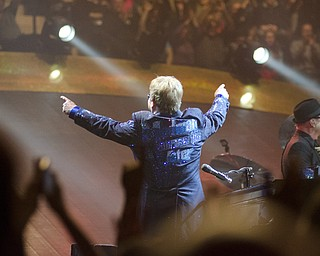 Katie Rickman | The Vindicator.Elton John points up at fans in the upper level after playing his second song at the Covelli Centre Saturday, February 1, 2014.
