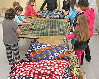 Fourth-, fifth- and sixth-grade students at Girard Intermediate School make tie-blankets. The girls donate the blankets, most recently to the Rescue Mission during the cold snap.