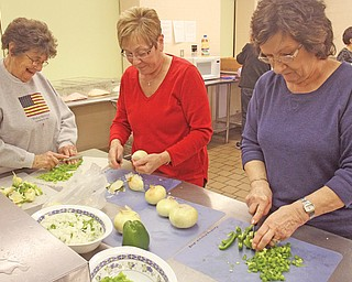 Members of St. Charles Borromeo Church in Boardman volunteer with the second Monday of the month kitchen crew. From left are Barbara Oliver, Mary Grace Fowler and Roe Palazzo. The food they make is served at St. Vincent de Paul dining hall in Youngstown.