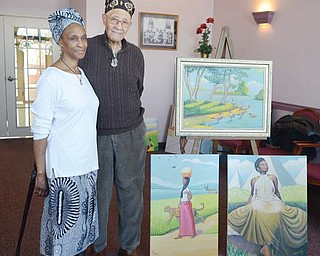 Local artist Joseph Thomas, right, stands with his wife, Gwendolyn, at Danridge's Burgundi Manor in Youngstown, where his original artwork will be displayed for three days during his annual gallery event.