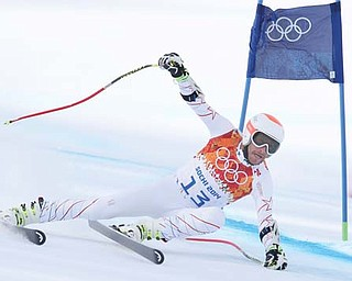 The United States' Bode Miller passes a gate Sunday in the men's super-G at the Winter Olympics in Krasnaya Polyana, Russia.