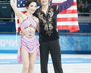 Meryl Davis and Charlie White of the United States pose for photographs after placing first in the ice dance free