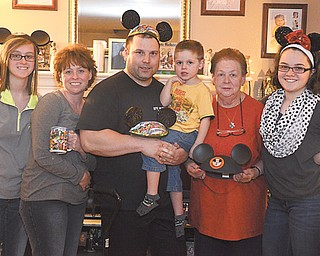 From left, Kelly Pesta, Mary Alice Sinkovich, Thomas Sinkovich Sr., Thomas Sinkovich Jr., Mary Powell and Rebecca Pesta show off souvenirs from their recent trip to the Walt Disney World Resort in Orlando, Fla.