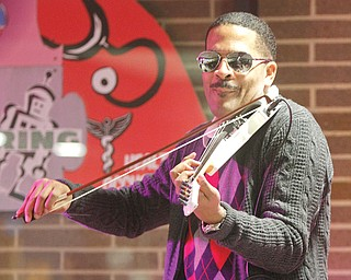 Jerald Daemyon , internationally acclaimed master violinist, lecturer, composer and recording artist, demonstrates his skills at a music workshop at Choffin Career and Technical Center. Daemyon conducted an interactive seminar for students Wednesday as part of Choffi n's Black History Month observance.