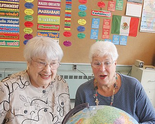 Leslie Kiske, left, and Bobbi Grinstein sit in one of the classrooms at The English Center. They founded the center when The International Institute in Youngstown closed in 1986. The center currently has 102 students from 32 countries.