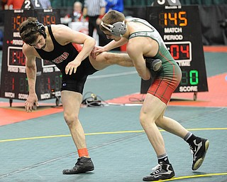 C.J. Frost of Canfield attempts to avoid being tripped by Josh Mossing of Toledo Central Catholic during their 138lb Division 2 championship bracket bout during the State High School Wrestling meet on February 27, 2014 at Jerome Schottenstein Center in Columbus, Ohio.