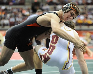 David-Brian Whister of Howland attempts to work to the back of Andrew Dunn of Hamilton Ross during their 152lb Division 2 championship bracket bout during the State High School Wrestling meet on February 27, 2014 at Jerome Schottenstein Center in Columbus, Ohio.